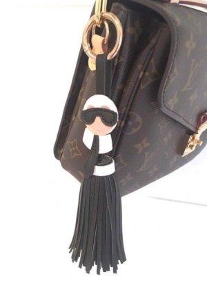 Porte-clés blanc-noir