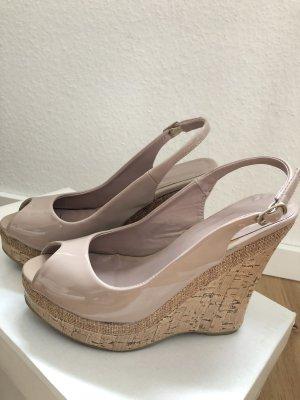 Sandalo alto con plateau color carne