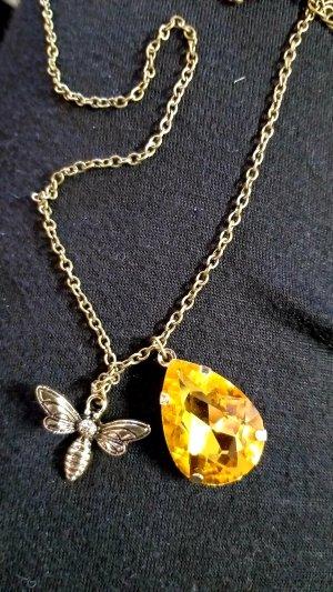 Collar naranja dorado