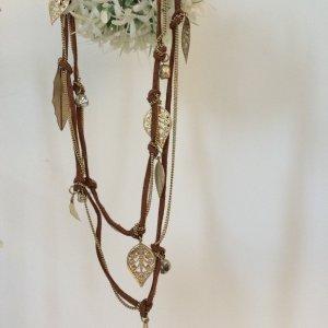 Collier brun-doré daim