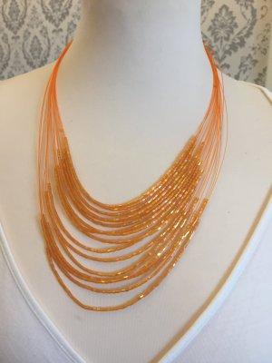 Kette Kleine Perlen orange super Zustand
