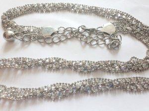 Cinturón pélvico color plata-gris claro metal