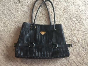 Klassiker von Maison Mollerus. Die Tasche ist ein geräumiger Shopper im typischen, speziell beschichteten Leinen-/Baumwollgewebe, welche mit dem berühmten Streifen und dem Phönix geprägt ist.