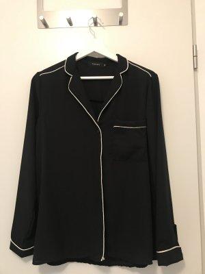 Klassische Bluse in schwarz mit weißen Nähten