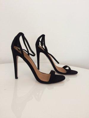 Klassische schwarze Riemchen High Heels