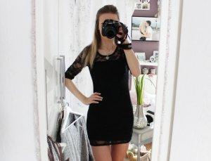 Kleid aus Spitze in schwarz