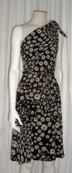 Kleid by Gucci / Schwarz mit Creme farbenen Blumen