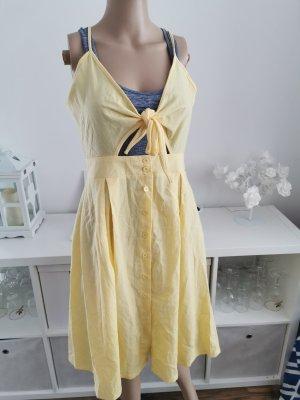 Cut out jurk lichtgeel