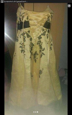 Kleid gelb mit schwarzer Stickerei