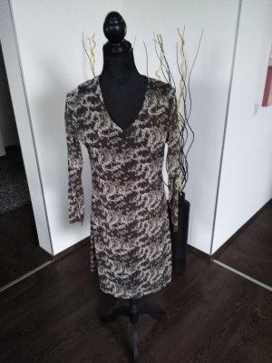 Kleid gemustert...an den Ärmeln tranzperenz