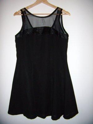 Kleid in schwarz mit perlen