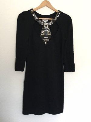 Kleid mit Cut Outs und Pailletten