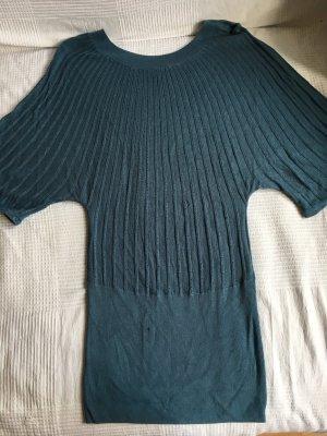 Kleid mit Gebrauchspuren