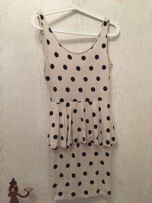 Kleid mit Punkten in leichtem beige