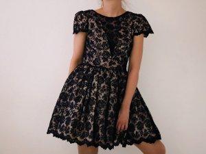 Babydoll-jurk goud-zwart
