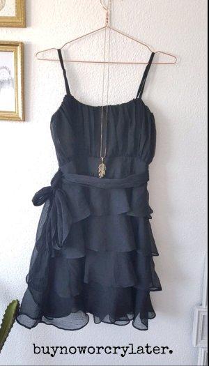 Kleid Schwarz kurz drapiert fallend Wasserfall Schleife