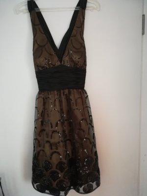 Kleid von Unique gold mit schwarzem Tüll