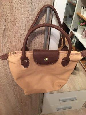 Kleine lachsfarbene Tasche