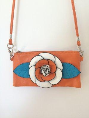 Kleine orangene Tasche mit Blume