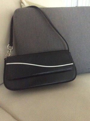 Kleine schwarz-weiße Schultertasche zu verkaufen