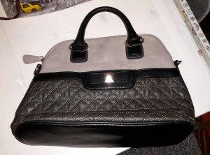 kleinere zweifarbige Handtasche