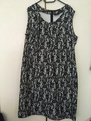 Knielanges Kleid schwarz-weiß mit Spitze
