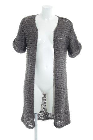 Kookai Chaleco de punto largo gris look casual