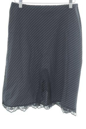 Kookai Falda midi negro-blanco estampado a rayas elegante