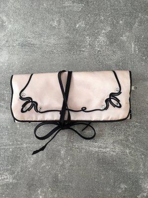 Bolso tipo pochette rosa-negro