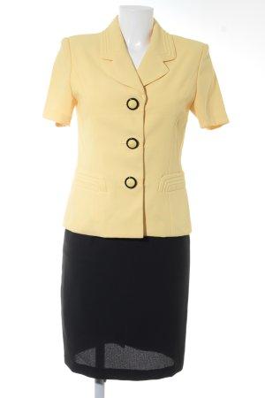 Tailleur jaune-noir style d'affaires