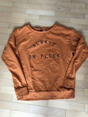 Kürbisfarbenes Sweatshirt mit Print