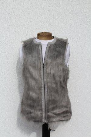 Vila Smanicato di pelliccia argento