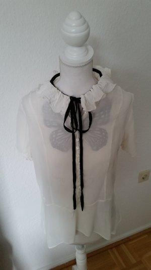 Kurzärmelige Bluse von Zara mit schönem Rüschendetail am Ausschnitt und Schleife