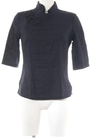 Kurzarm-Bluse schwarz florales Muster extravaganter Stil