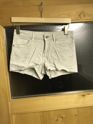 Pantalón pirata crema