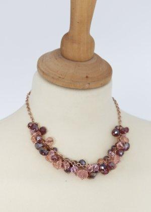 kurze Kette in rosegold mit rosa und dunkelroten Perlen