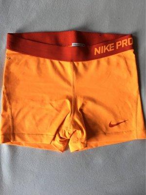 Nike Pantalone da ginnastica arancio neon-rosso