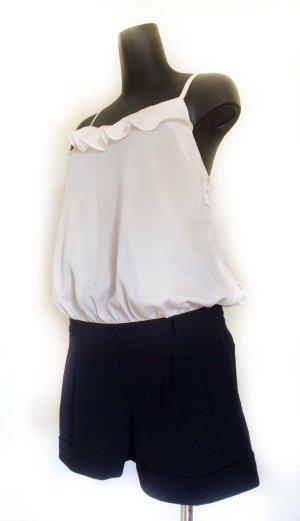 Blusa tipo body negro-blanco puro