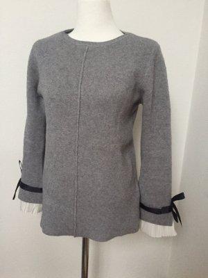 Kuscheliger Pullover mit edlen Details