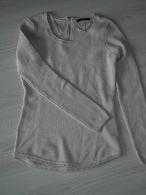 Kuscheliger rosa Pullover