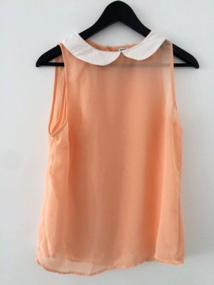 Lachsfarbene Bluse mit weißem Kragen
