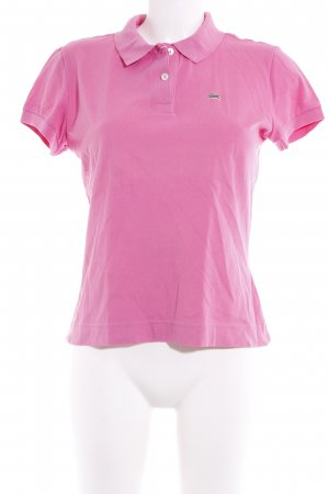 Lacoste Camiseta tipo polo rosa look casual