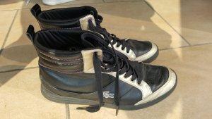 Lacoste Sneakers High Top schwarz gold Leder 38