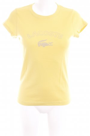 Lacoste Camiseta amarillo limón estampado temático look casual