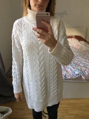 Länger Pullover aus Strick