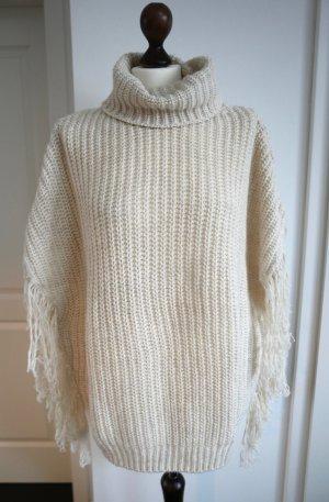 Lässiger Poncho-Pullover mit Fransen in creme