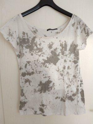 Camisa de un solo hombro blanco-gris claro
