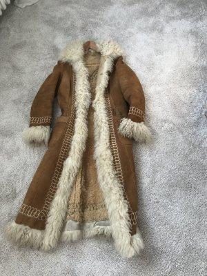 Manteau de fourrure brun sable pelage