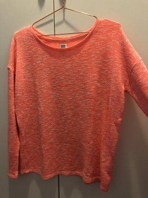 Langärmlig orangenes Shirt