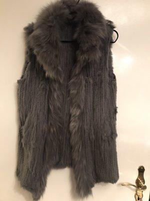 Smanicato di pelliccia grigio Pelliccia